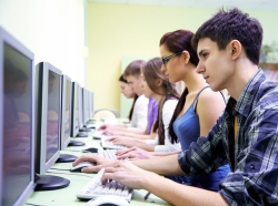 high school students using computers, boy blue plaid shirt