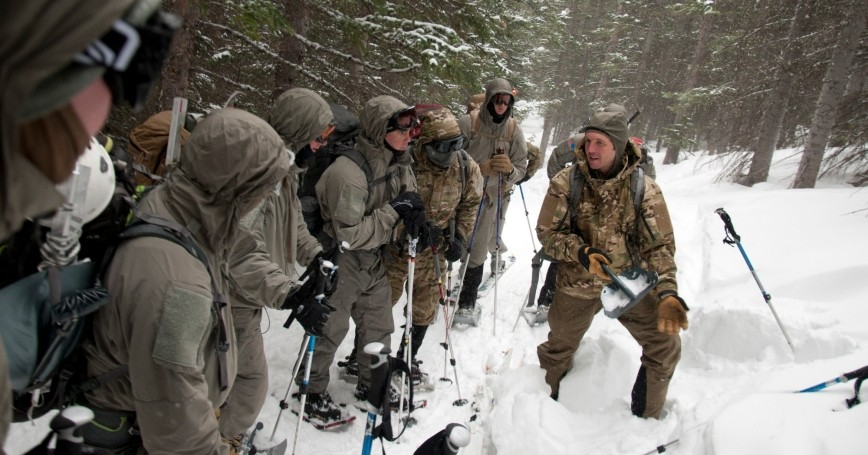 A Special Forces Master Mountaineering Course instructor teaches students to assess a snow pack in order to determine the likelihood of an avalanche