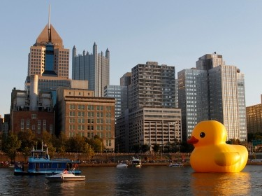 A 40-foot-high inflatable rubber duck, created by Dutch artist Florentijn Hofman, is towed up the Allegheny River in Pittsburgh, Pennsylvania, September 2013