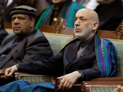 Afghan President Hamid Karzai attends the last day of the Loya Jirga, in Kabul November 24, 2013