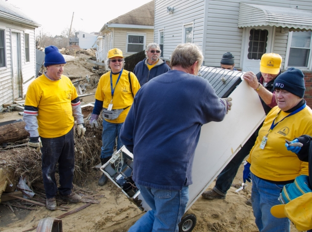 Volunteers from the North Carolina Southern Baptists help clean out some apartments that were flooded during Hurricane Sandy