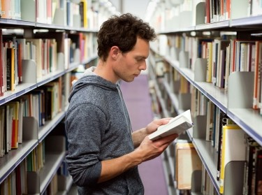 man reading in a library