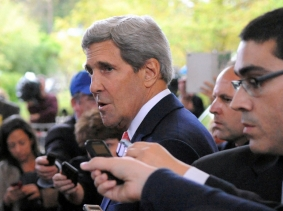 U.S. Secretary of State John Kerry addresses an international assembly of reporters upon arriving in Geneva