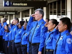 A line of TSA personnel salute the U.S. Honor Flag procession as it leaves LAX at a ceremony in memory of TSA agent Gerardo Hernandez November 6, 2013