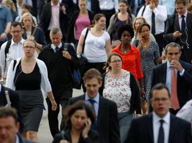 Commuters walking across London Bridge