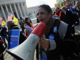 Obama healthcare law supporters rally during the third and final day of legal arguments over the Patient Protection and Affordable Care Act at the Supreme Court in Washington, March 28, 2012