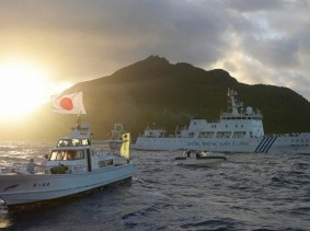 Chinese marine surveillance ship sails near Japan Coast Guard vessels and a Japanese fishing boat in front of one of the disputed islands, called Senkaku in Japan and Diaoyu in China