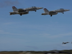 F/A-18C Hornets fly from Andersen Air Base, Guam, during exercise Forger Fury II, 5 December, 2013