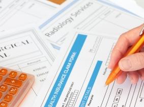 health insurance claim form, pen, calculator