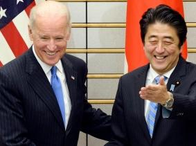 U.S. Vice President Joe Biden is welcomed by Japanese Prime Minister Shinzo Abe before their talks in Tokyo