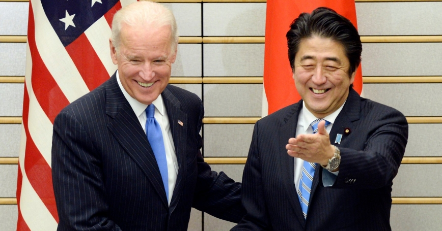 U.S. Vice President Joe Biden is welcomed by Japanese Prime Minister Shinzo Abe before their talks in Tokyo