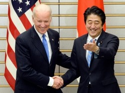 U.S. Vice President Joe Biden is welcomed by Japanese Prime Minister Shinzo Abe before their talks in Tokyo December 3, 2013