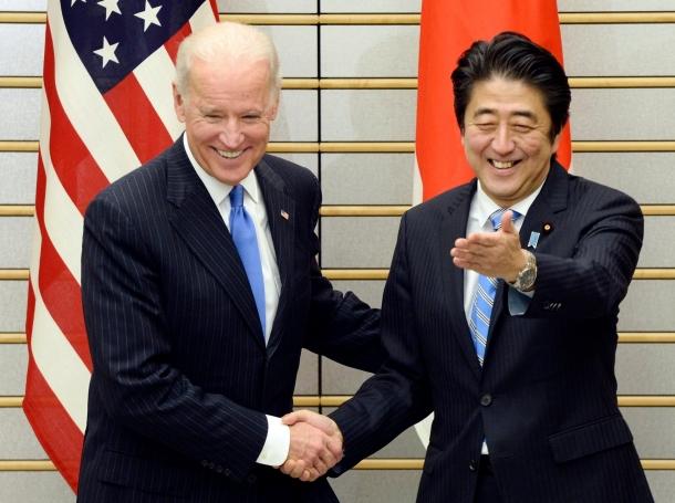 U.S. Vice President Joe Biden is welcomed by Japanese Prime Minister Shinzo Abe before their talks in Tokyo December 3, 2013