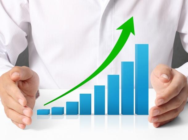 a rising bar chart between a person's hands