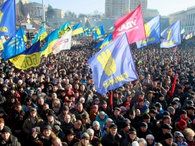 Pro-European integration protesters wave flags during a rally in Independence square in Kiev December 22, 2013