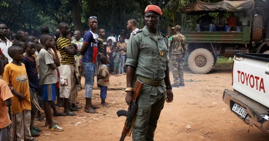 Soldiers of the Multinational Force of Central Africa watch over a crowd during a religious reconciliation tour in the outskirts of Bangui, December 11, 2013