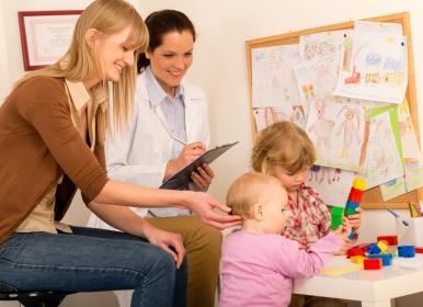 teacher and pediatrician observing children