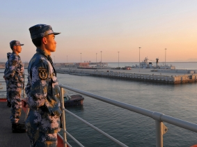 Chinese naval soldiers stand guard on China's first aircraft carrier Liaoning