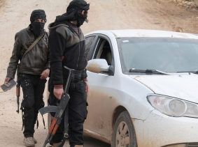 Members of Islamist Syrian rebel group Jabhat al-Nusra man a checkpoint on the border crossing between Syria and Jordan