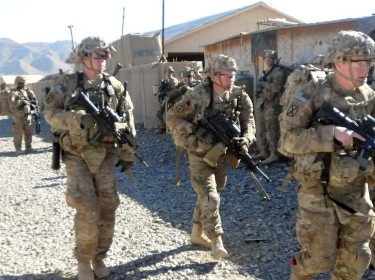 Soldiers move to secure a helicopter landing zone in Paktika Province
