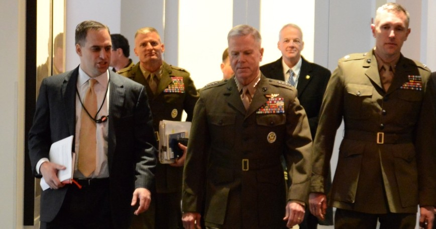 Marine Corps Commandant James F. Amos (center) talks to RAND's Seth Jones (left) during a visit to RAND's Washington office Tuesday.