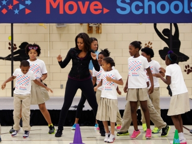 U.S. First Lady Michelle Obama exercises with children at Orr Elementary School in Washington