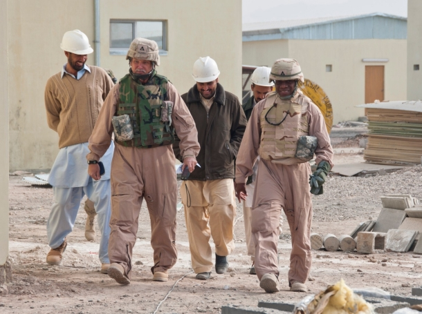Contractor personnel inspect an Afghan national police facility
