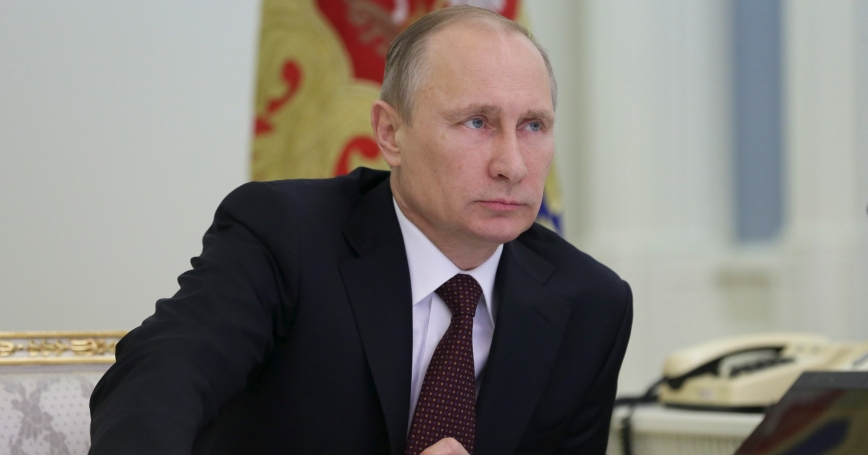 Russian President Vladimir Putin takes part in a video conference in Moscow's Kremlin