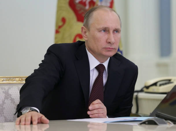 Russian President Vladimir Putin takes part in a video conference in Moscow's Kremlin December 23, 2013