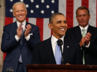 Vice President Joe Biden and Speaker of the House John Boehner applaud as President Barack Obama finishes his State of the Union speech on Capitol Hill in Washington, January 28, 2014