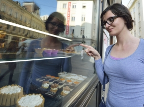 woman looking into a bakery window
