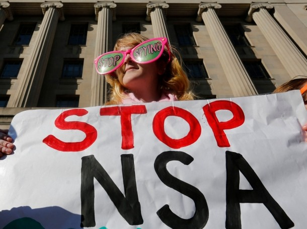 Member of the protest group, Code Pink, protests against U.S. President Obama and the NSA before his arrival at the DOJ in Washington, January 17, 2014