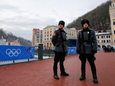 Russian Cossacks stand guard near the Rosa Khutor Alpine Resort in Krasnaya Polyana near Sochi