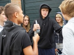 A group of teenagers drinking outdoors