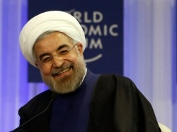 Iran's President Hassan Rouhani smiles during a session at the annual meeting of the World Economic Forum