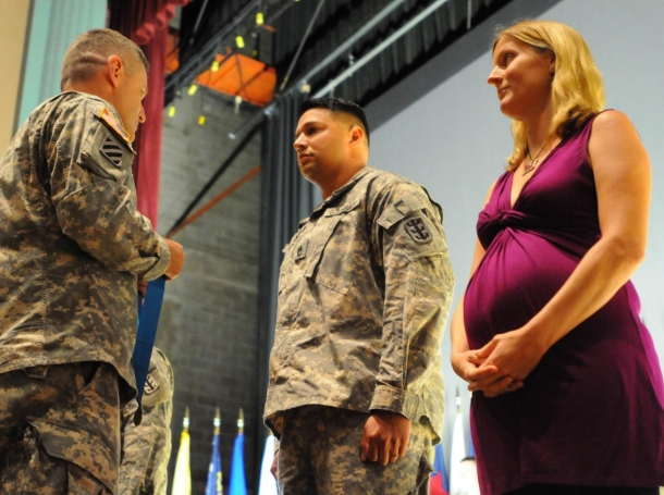 Sgt. First Class Richard Martinez is given the Milton Award that recognizes achievements in military intelligence during a redeployment ceremony
