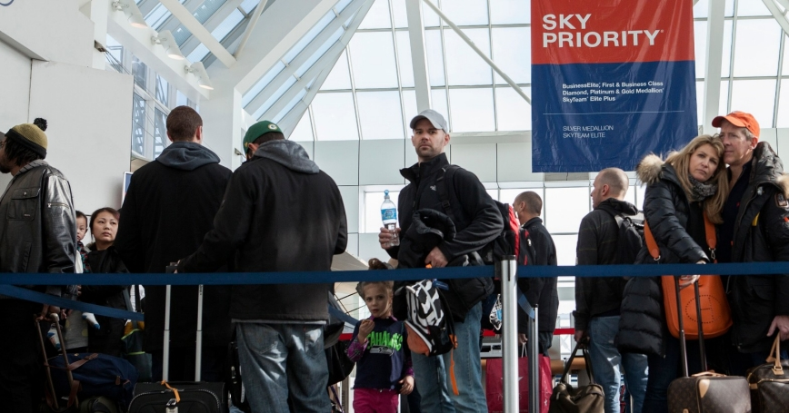Passengers line up in LaGuardia Airport as it was reopened after being evacuated due to a suspicious package being found by a baggage handler, Feb. 4, 2014