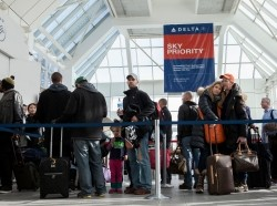 Passengers line up in LaGuardia Airport as it was reopened after being evacuated due to a suspicious package being found by a baggage handler, February 4, 2014