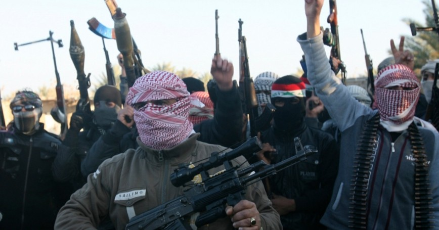 Masked Sunni gunmen chant slogans during a protest against Iraq's Shiite-led government