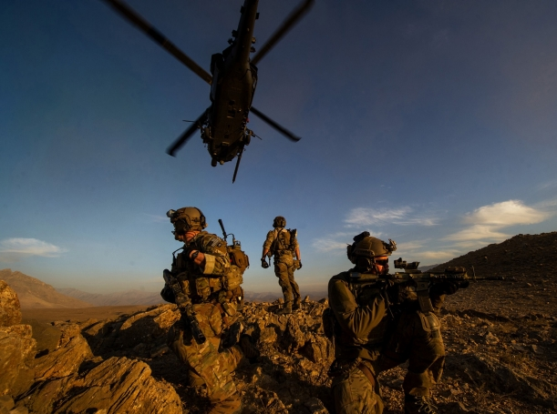 Pararescuemen secure the area after being lowered from an HH-60 Pave Hawk during a mission in Afghanistan
