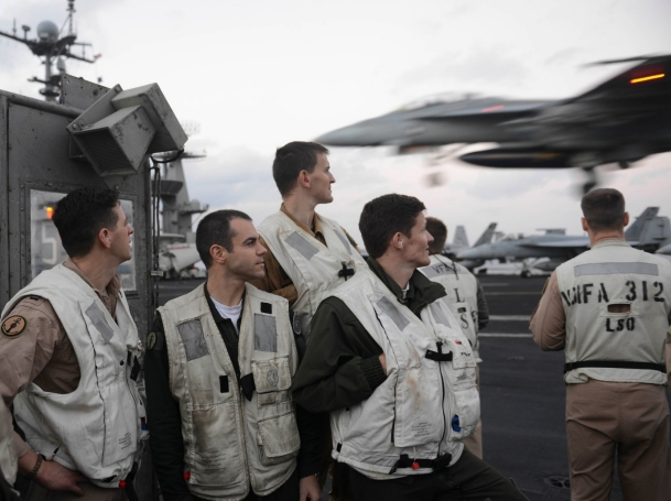 French sailors assigned to the French aircraft carrier FS Charles de Gaulle observe an aircraft recovery cycle aboard the aircraft carrier USS Harry S. Truman