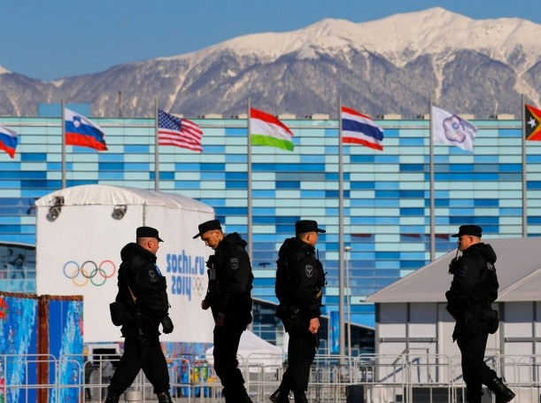 Security personnel patrol the Olympic Park at the 2014 Sochi Winter Olympic Games
