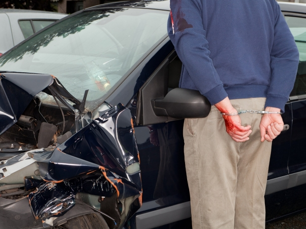 man being arrested for drunk driving after an accident