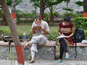 Indian students study inside the Delhi University campus in New Delhi