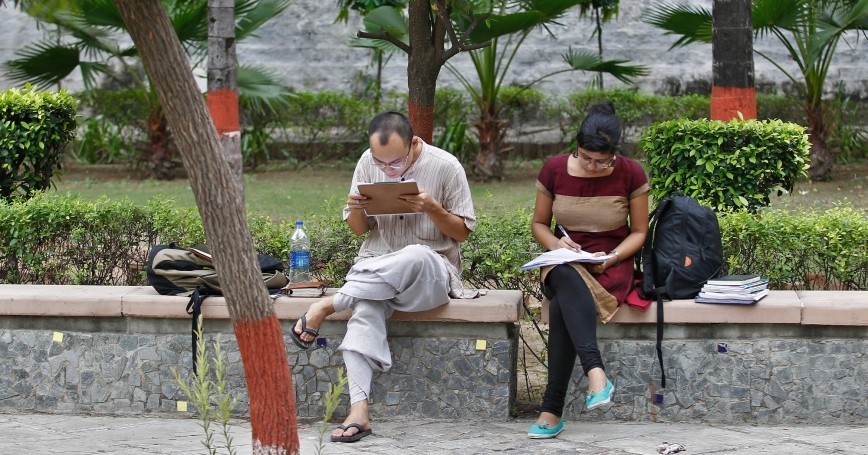 Indian students study inside the Delhi University campus in New Delhi