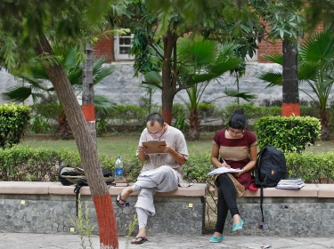 Indian students study inside the Delhi University campus in New Delhi September 20, 2013