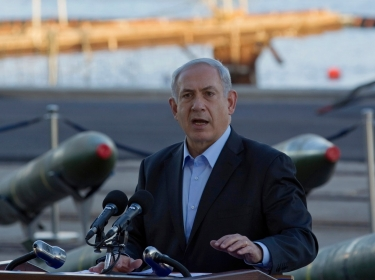 Israel's Prime Minister Benjamin Netanyahu, displaying on Monday what Israel said were seized Iranian-supplied missiles bound for militants in Gaza. He called on the West not to be fooled by Tehran's diplomatic outreach over its nuclear program.