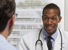 smiling doctor with patient
