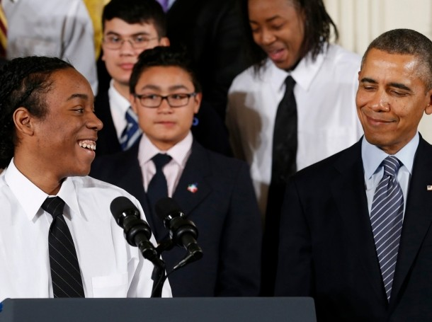 """U.S. President Barack Obama is introduced to speak by Christian Champagne from Chicago at the unveiling of Obama's """"My Brother's Keeper"""" initiative"""