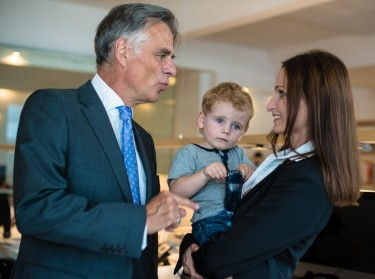 businesswoman holding her child in the office